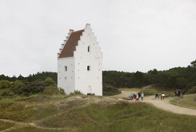 The sand-covered church